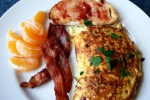 Omelette, Bacon, Tangerine and Toast.